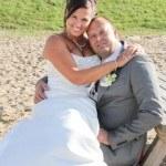 Onze bruiden, Bruid Brenda op schoot bij haar man.